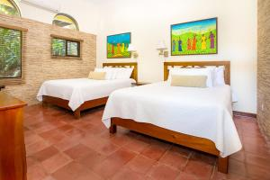 A bed or beds in a room at Hotel Villas Nicolas - Adults Only