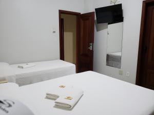 Cama ou camas em um quarto em Hotel Danúbio