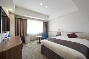A bed or beds in a room at HOTEL VISCHIO AMAGASAKI by GRANVIA