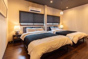 Bijou Suites Naniwaにあるベッド