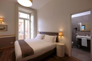 Un ou plusieurs lits dans un hébergement de l'établissement Napoli Class