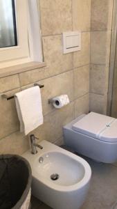 Ein Badezimmer in der Unterkunft Abbazia Apartaments