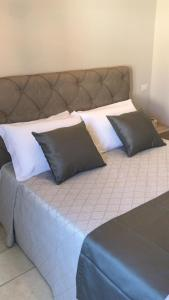 Ein Bett oder Betten in einem Zimmer der Unterkunft Abbazia Apartaments