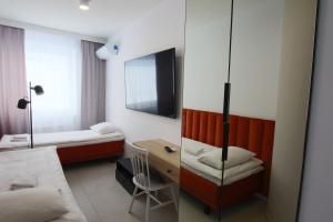 Łóżko lub łóżka w pokoju w obiekcie Apartamenty Bohaterów Kragujewca 6