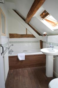 A bathroom at Whitewells Farm Cottages