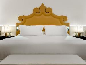 Cama o camas de una habitación en H10 Casa de la Plata