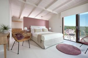 A bed or beds in a room at Villa Niolos II