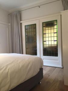 Postel nebo postele na pokoji v ubytování Beau City Apartment Maastricht