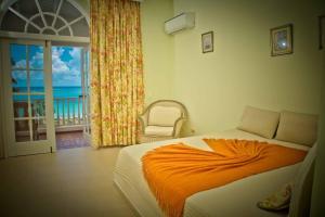 Ein Bett oder Betten in einem Zimmer der Unterkunft Hotel Villa Serena