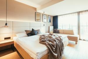 Ein Bett oder Betten in einem Zimmer der Unterkunft Hotel Kowald Loipersdorf