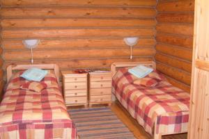 Кровать или кровати в номере База отдыха «Бриз»