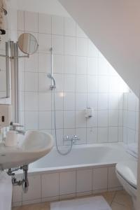 Ванная комната в Hotel Geyer
