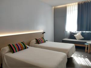 A bed or beds in a room at Centre Esplai Albergue