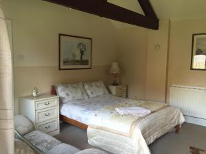 A bed or beds in a room at RolandsCroft Guest House
