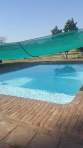 The swimming pool at or near Grace Lodge