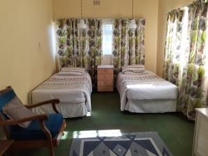A bed or beds in a room at Grace Lodge