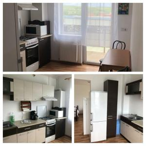 A kitchen or kitchenette at Sclipici Apartament