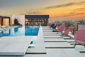 The swimming pool at or close to Grand Hyatt Athens