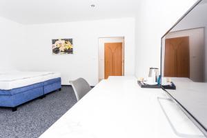 Postel nebo postele na pokoji v ubytování TIF hotel & restaurant