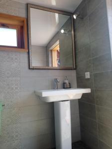 Ванная комната в Guest House Usadba Okhotnika