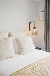 A bed or beds in a room at D8 - Shoreditch