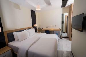 A bed or beds in a room at The Edge by Wellness