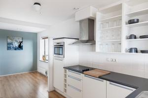 A kitchen or kitchenette at The Penthouse At The Hague Tower