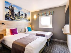 A bed or beds in a room at ibis Styles London Excel