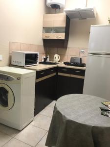 A kitchen or kitchenette at Kauņas 63