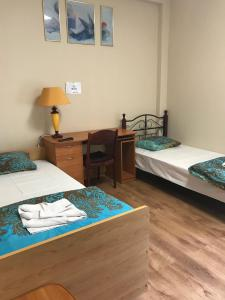 A bed or beds in a room at Kauņas 63