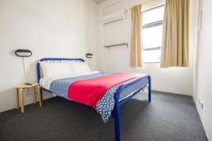 A bed or beds in a room at Perth City YHA