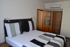 A bed or beds in a room at Like Home Apartments Prague