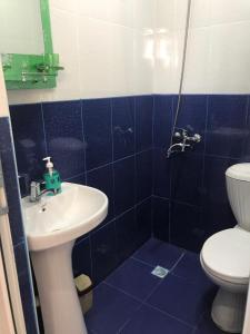 Um banheiro em Alp Hotel