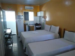 Cama ou camas em um quarto em Pousada Temporada Maceió
