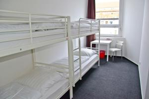 A bunk bed or bunk beds in a room at Check In Hostel Berlin