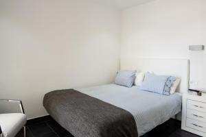 A bed or beds in a room at Villas de la Marina
