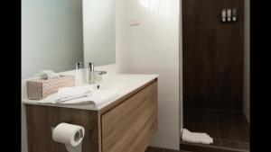 A bathroom at Black Forest Motel