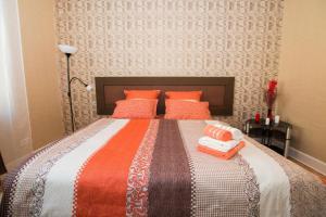 Кровать или кровати в номере Apartment on Tverskaya