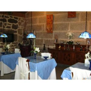 A restaurant or other place to eat at Casa Grande Do Ribeiro