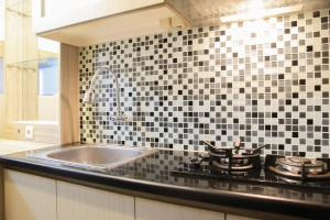 A kitchen or kitchenette at Simply Studio Apartment @ Grand Dhika City By Travelio
