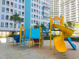 Children's play area at Relaxing Studio @ Grand Dhika City Apartment By Travelio