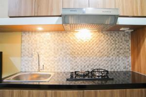 A kitchen or kitchenette at Relaxing Studio @ Grand Dhika City Apartment By Travelio