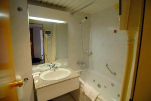 Ванная комната в Slavyanskaya Hotel
