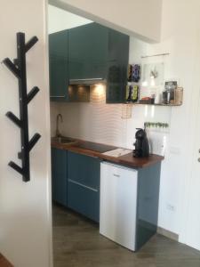 A kitchen or kitchenette at Maison Lumière