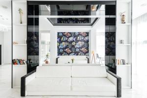 A bed or beds in a room at Mirage Medspa Hotel