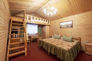 Кровать или кровати в номере Спортивный Парк Волен