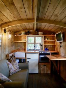 A kitchen or kitchenette at The Wayside Shepherd Hut