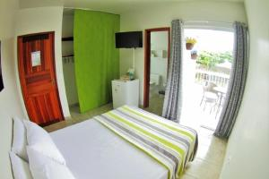 A bed or beds in a room at Pousada Serrate