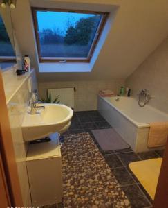 Ein Badezimmer in der Unterkunft Inseldorf Wardt