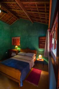 Cama ou camas em um quarto em Lagamar Ecohotel